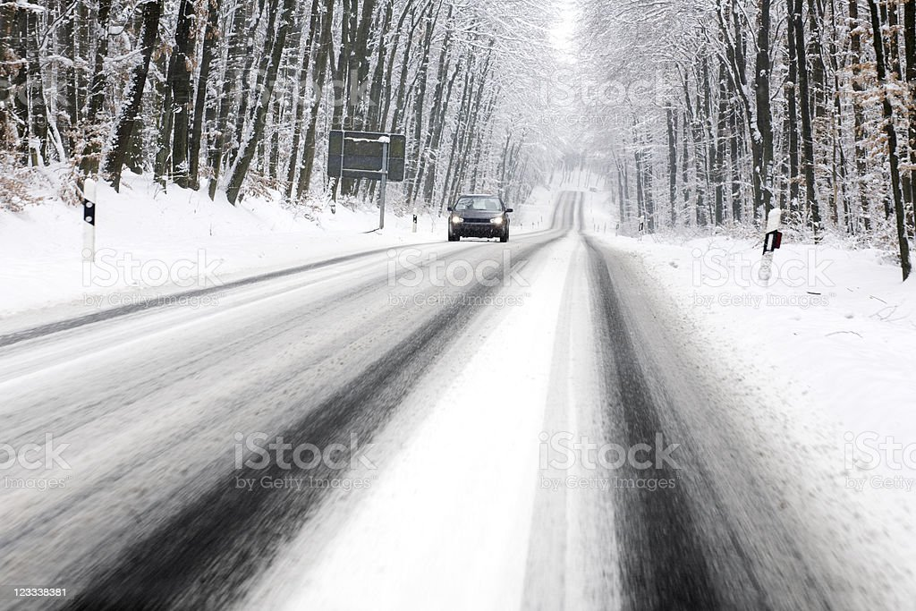Road through winter forest stock photo