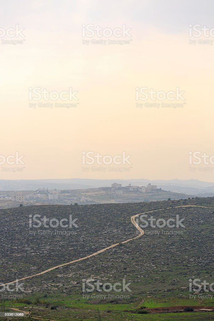 Road to a Palestinian village at sunset stock photo