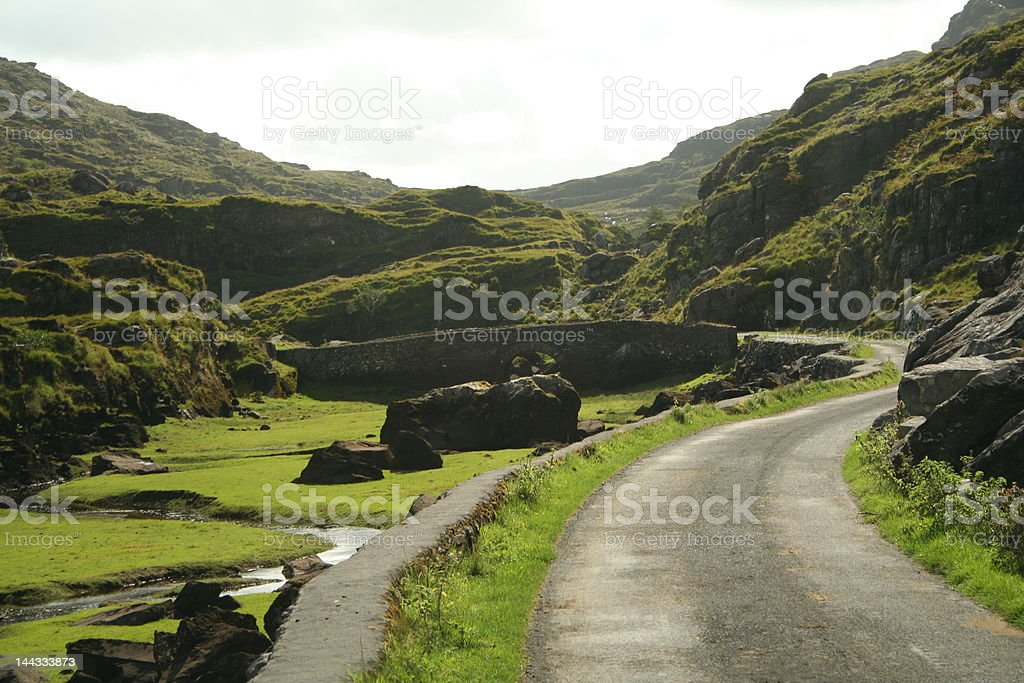 Road to bridge over small creek royalty-free stock photo