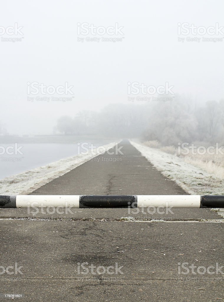 road to far away with barrier on freeze landscape stock photo