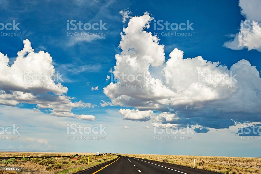 Road to Holbrook Arizona with beautiful clouds stock photo