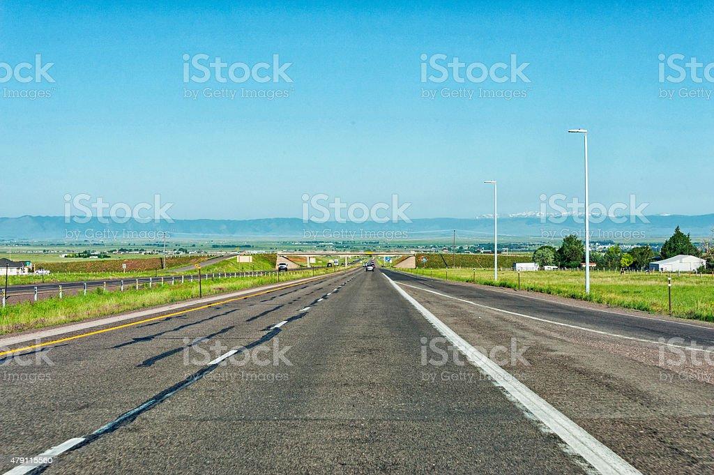 Road to Laramie and Snow Topped Mountains stock photo