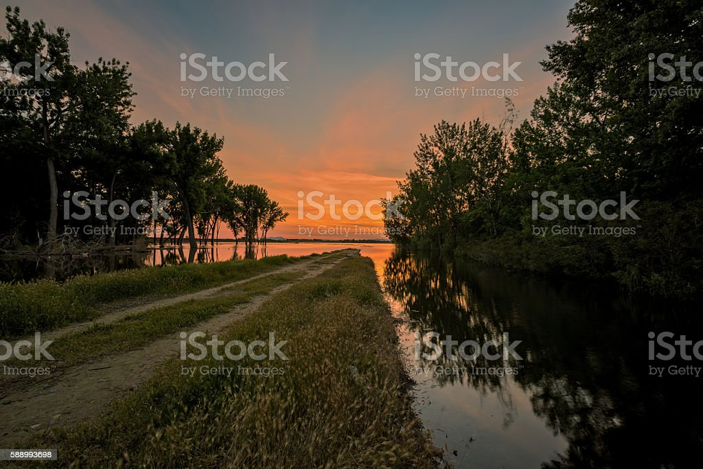 Road to nowhere leans into a lake in Idaho stock photo