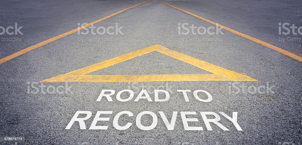 Road to recovery direction concept stock photo