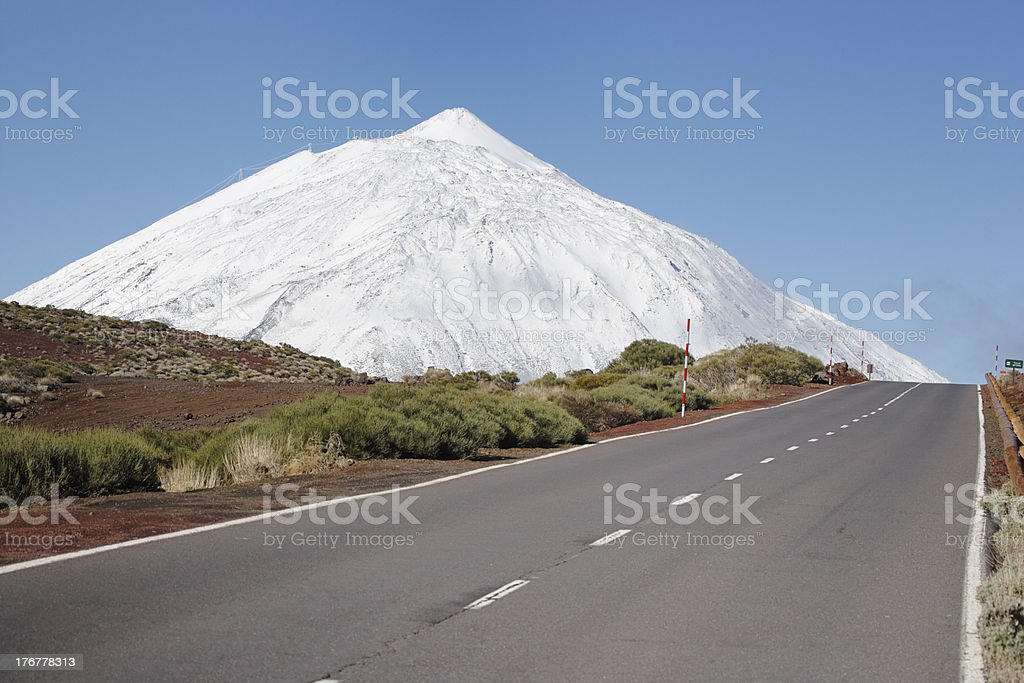 road to snowcapped mountain, volcano Pico de Teide, Tenerife royalty-free stock photo