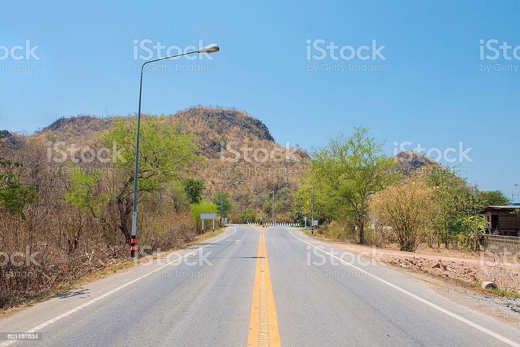 Road to the autumn mountains. Kanjanaburi, Thailand stock photo