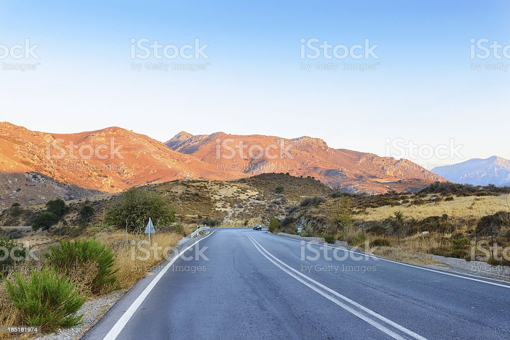 Road to the mountains on sunset royalty-free stock photo