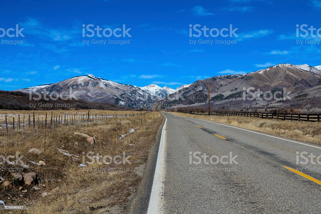 Road to the snow covered peaks in the Rocky Mountains stock photo