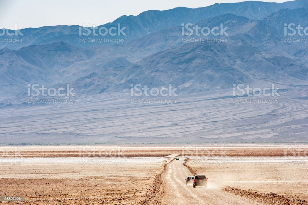 Road towards Devil's Golfcourse in Death Valley National Park California stock photo