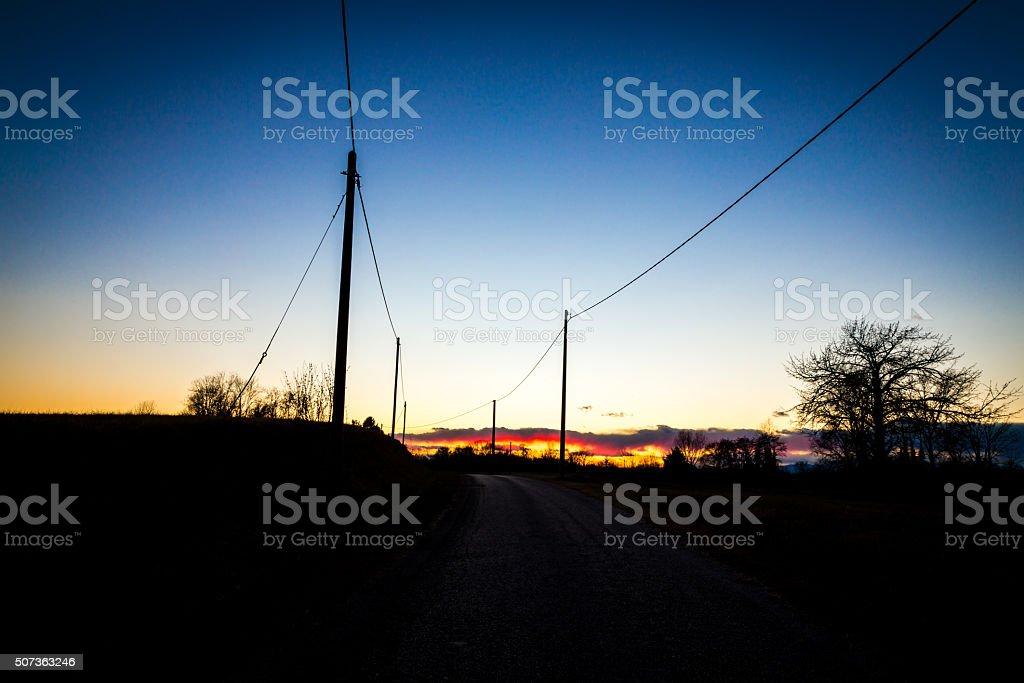 road towards the sunset stock photo