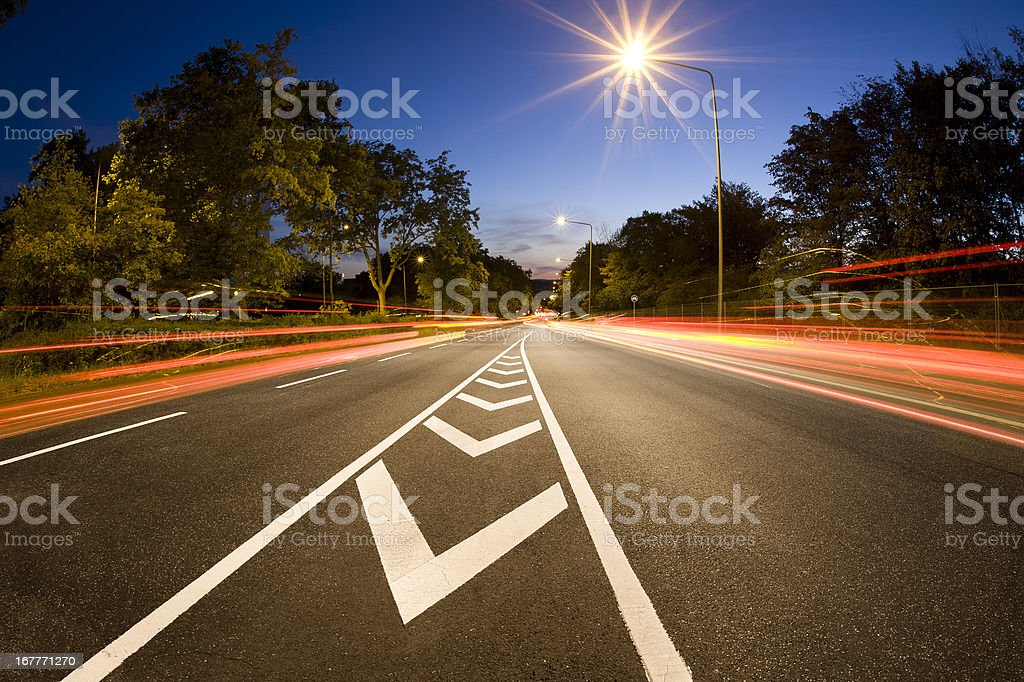 Road traffic at dusk, motion blur stock photo