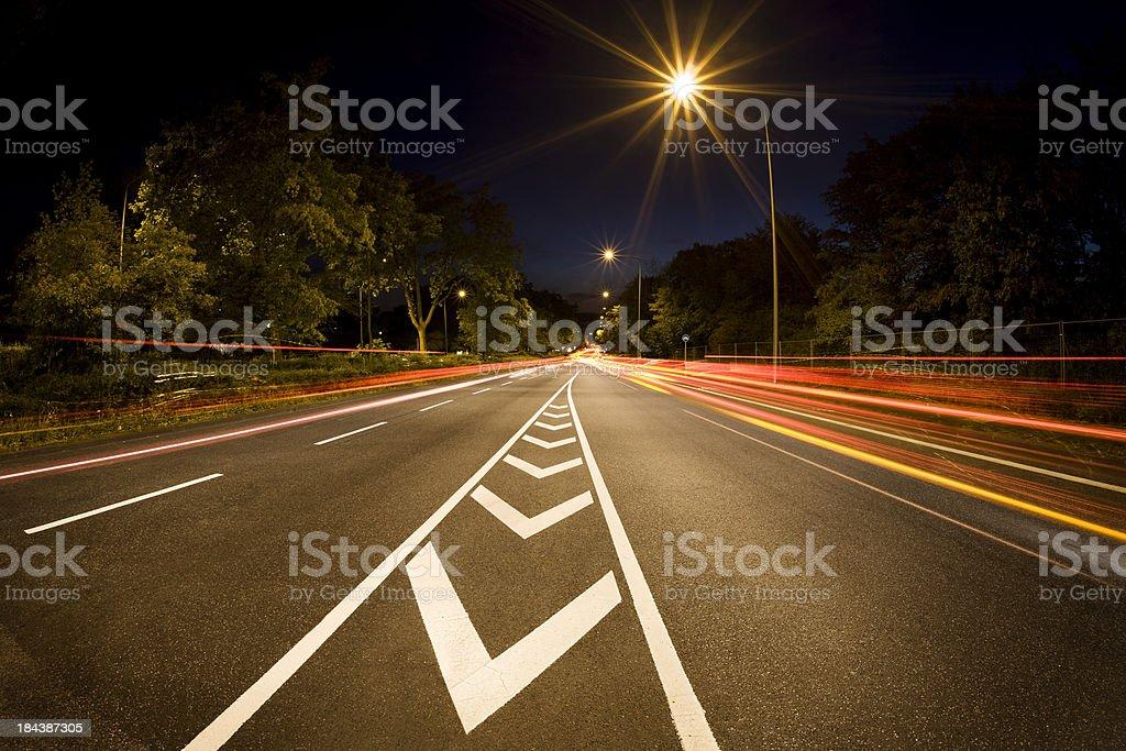 Road traffic at night, motion blur stock photo