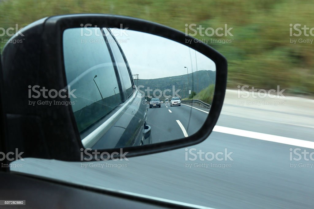 Road traffic captured in car mirror stock photo