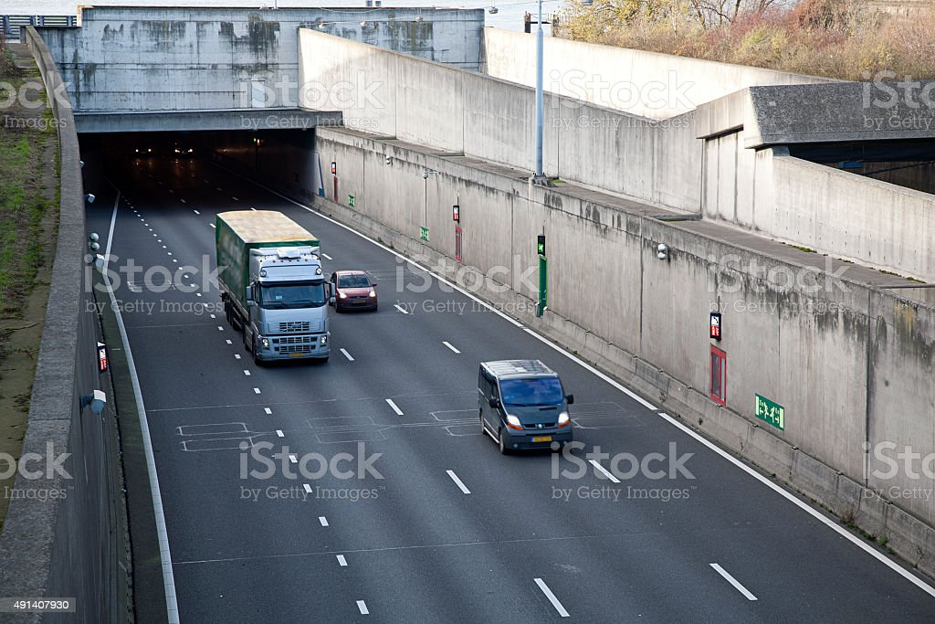 Road traffic driving out of tunnel stock photo