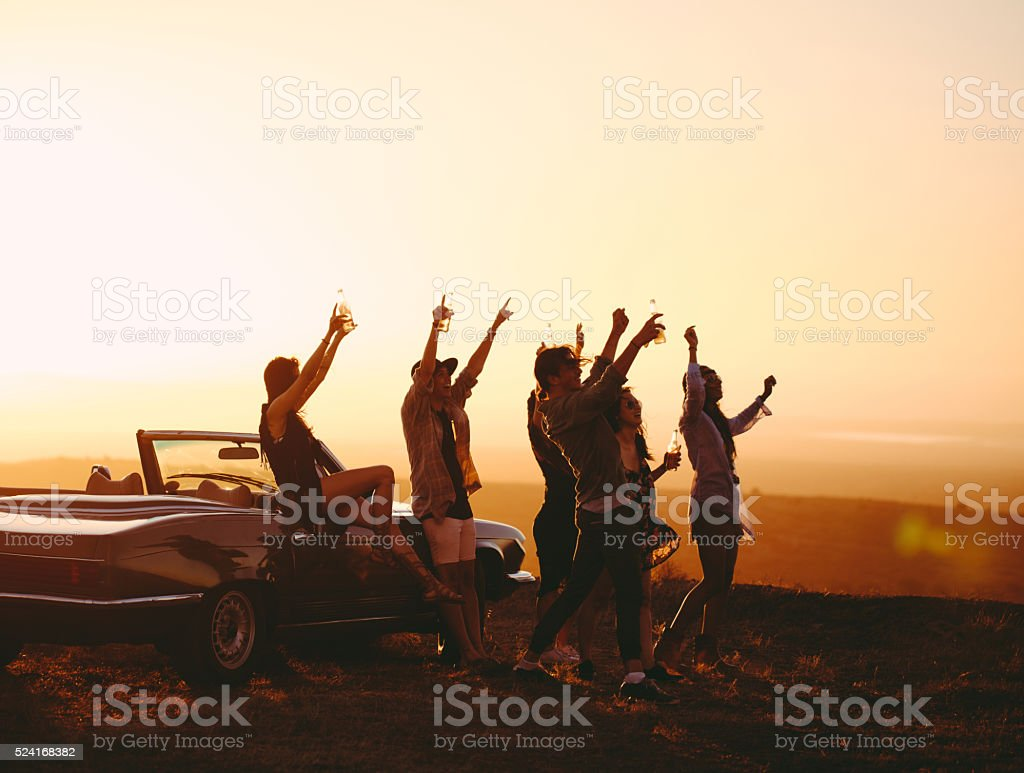Road trip Friends partying outdoor on a summer evening stock photo