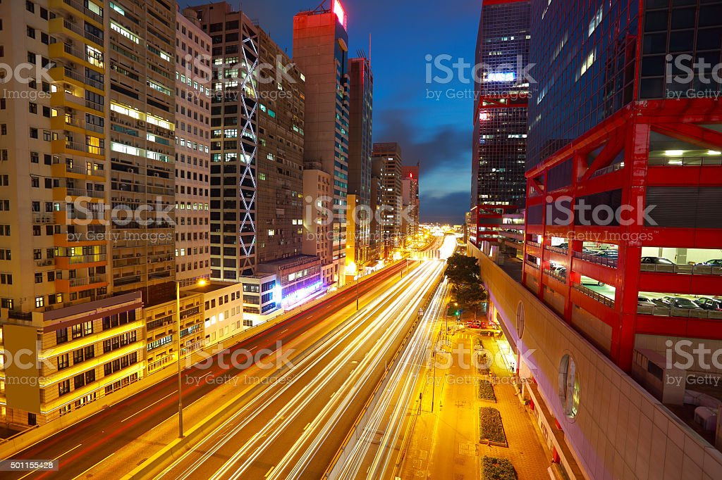 Road tunnels light trails on modern city buildings backgrounds stock photo