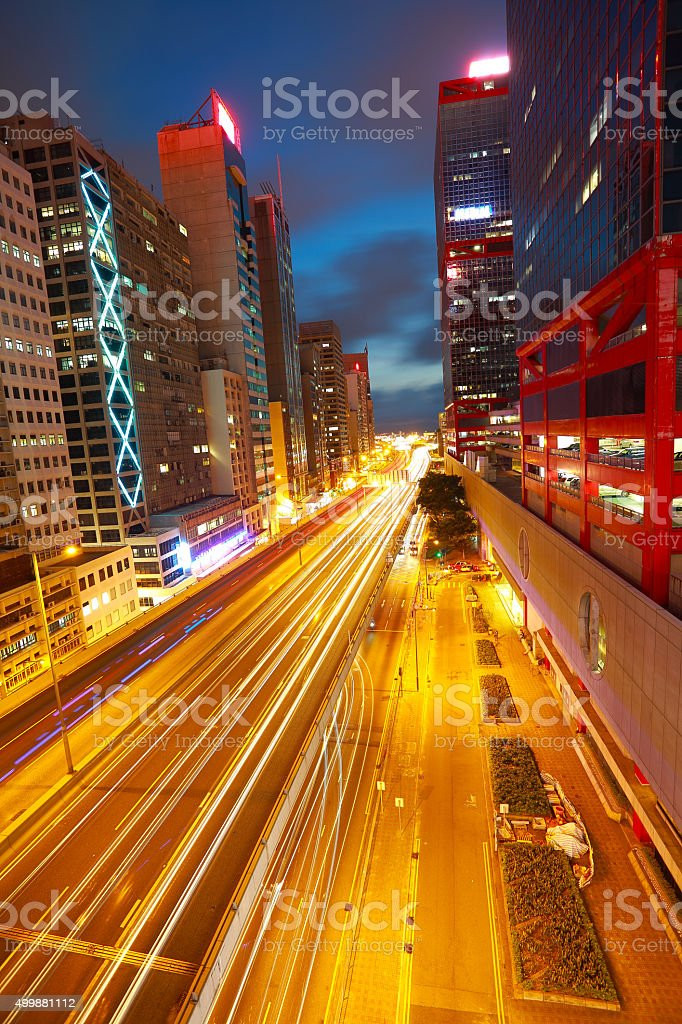 Road tunnels light trails on modern city buildings in HongKong stock photo