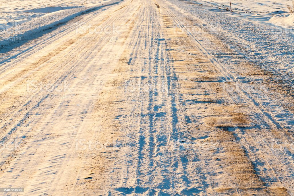 road under the snow stock photo