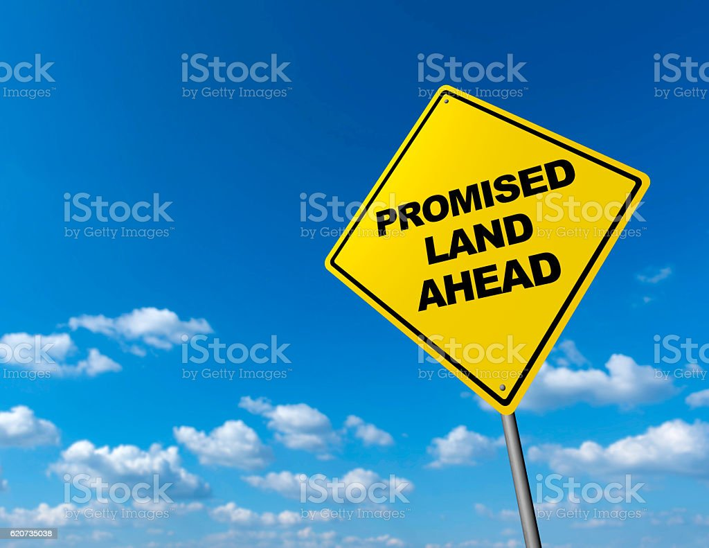 PROMISED LAND AHEAD - Road Warning Sign stock photo