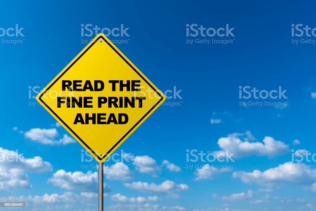READ THE FINE PRINT AHEAD - Road Warning Sign stock photo