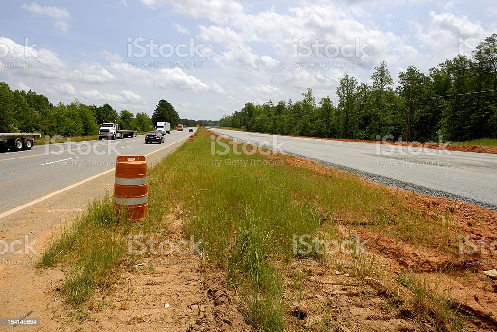 Road widening and construction in rural area stock photo