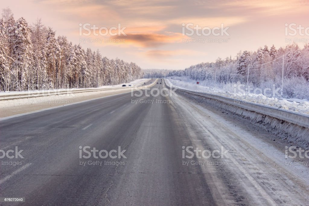 Road winter, evening hours, through the forest stock photo