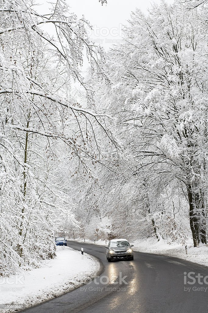 Road with car in winter forest - hoar frost royalty-free stock photo