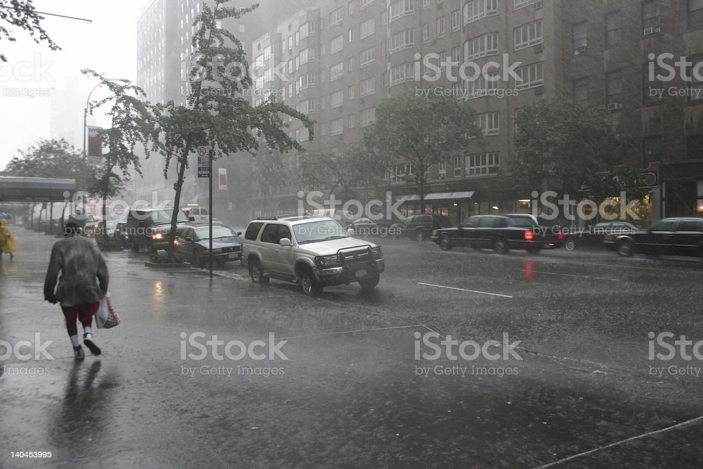 Road with cars in stormy weather people running stock photo