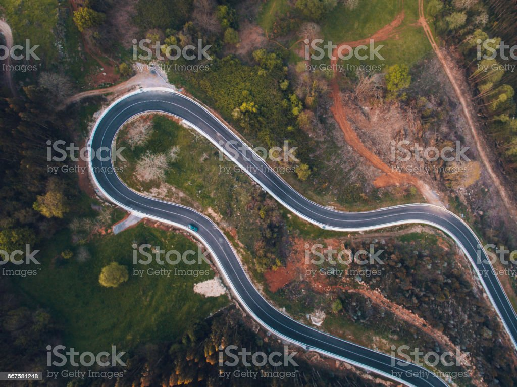 Road with curves from above stock photo