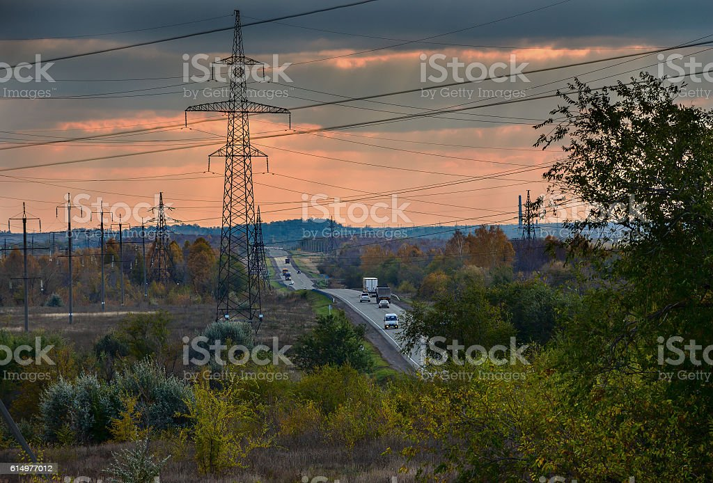 Road with High voltage power pylons stock photo