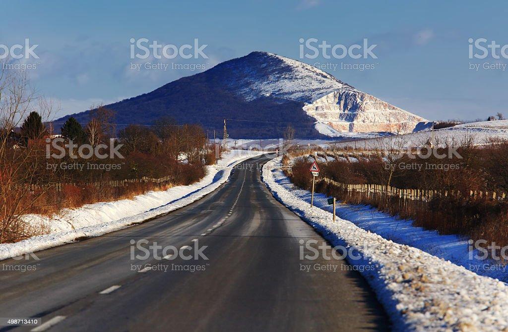 Road with mountain scene in winter stock photo
