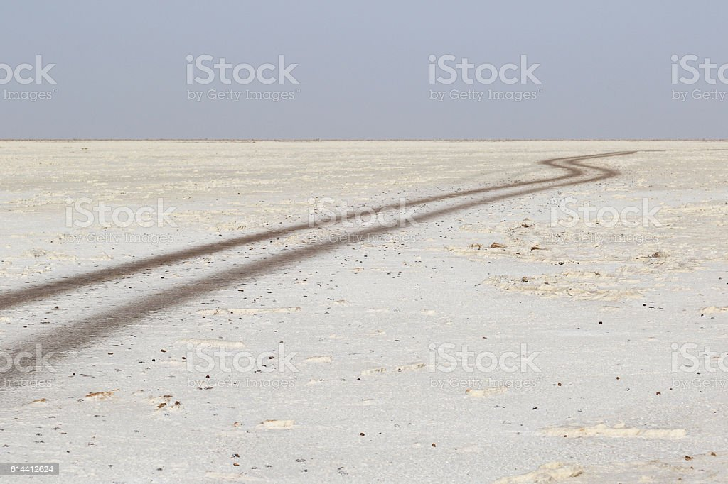 Road with no traffic in the danakil depression, ethiopia africa stock photo