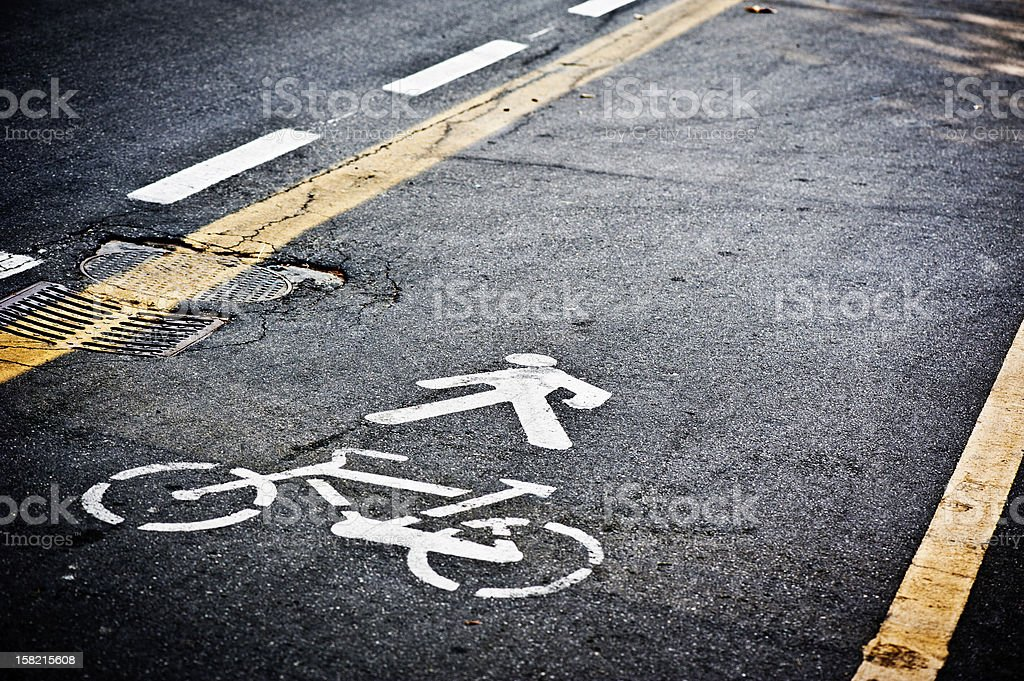 Road with Pedestrian and Bicycle Signal Printed on the Ground stock photo