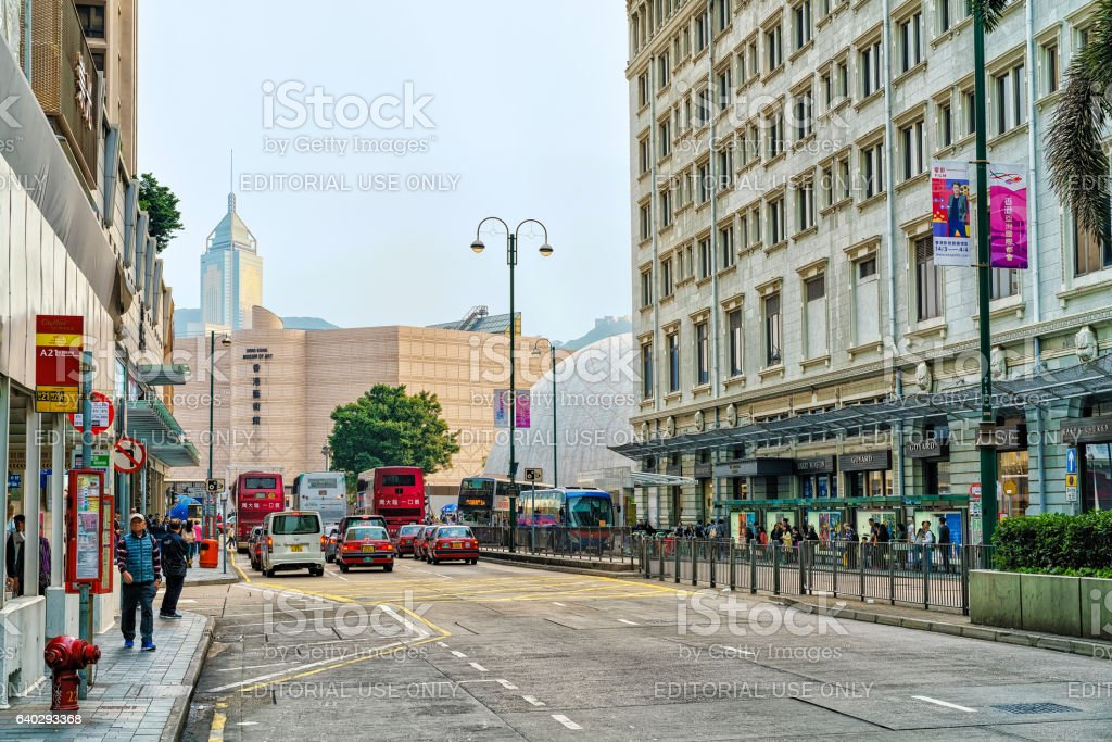 Road with people and traffic Tsim Sha Tsui Kowloon HK stock photo