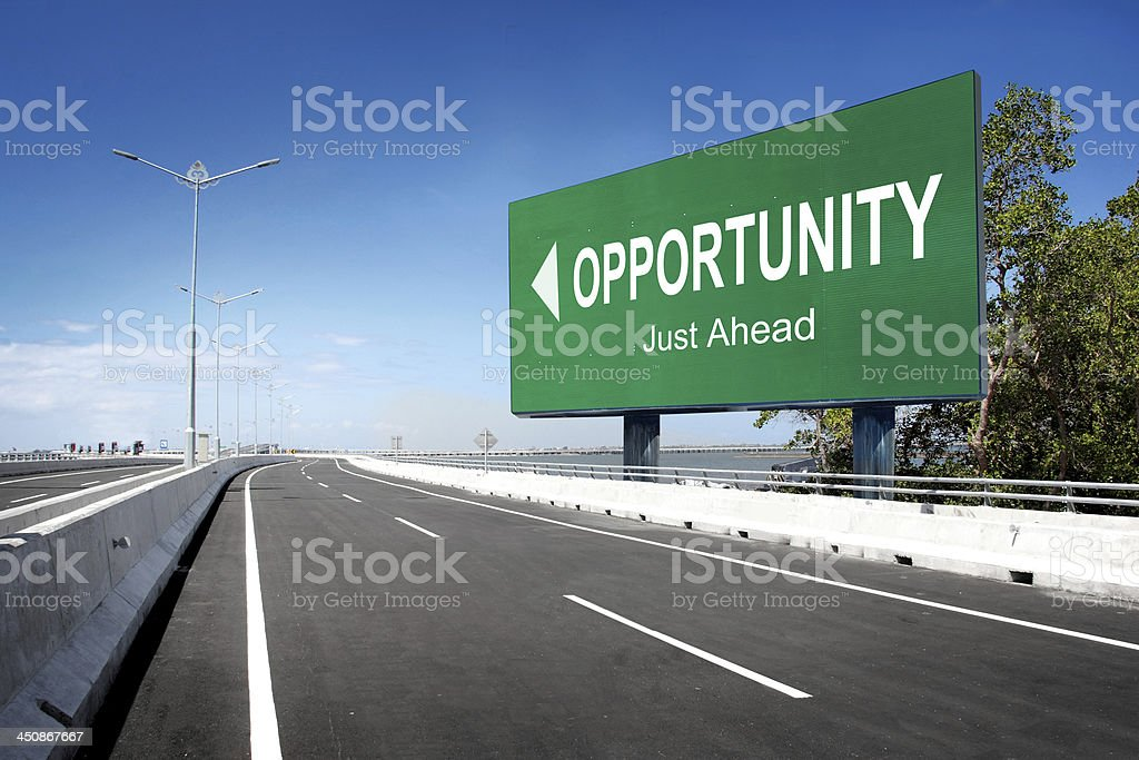 road with sign of opportunity stock photo