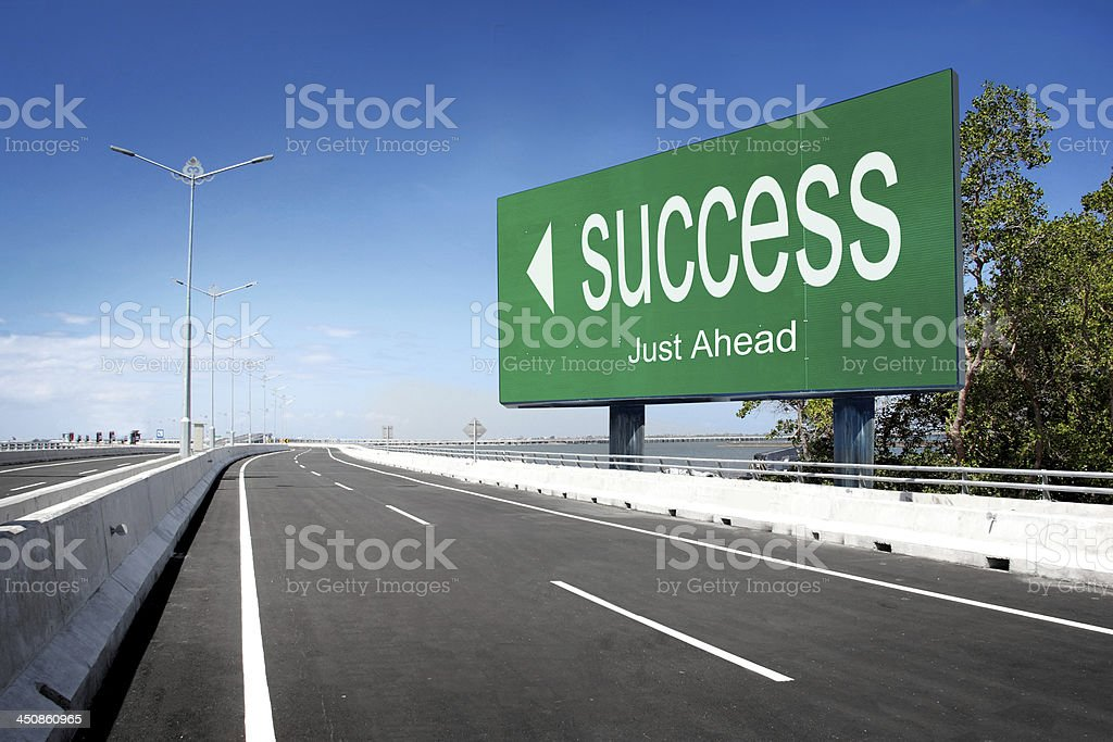 road with sign of success stock photo