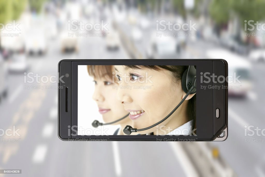 Road with the operator on the mobile screen stock photo