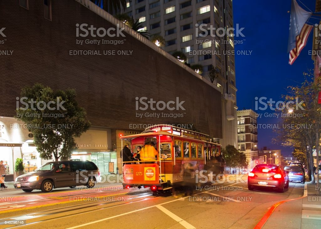 Road with tramway in san francisco at night stock photo
