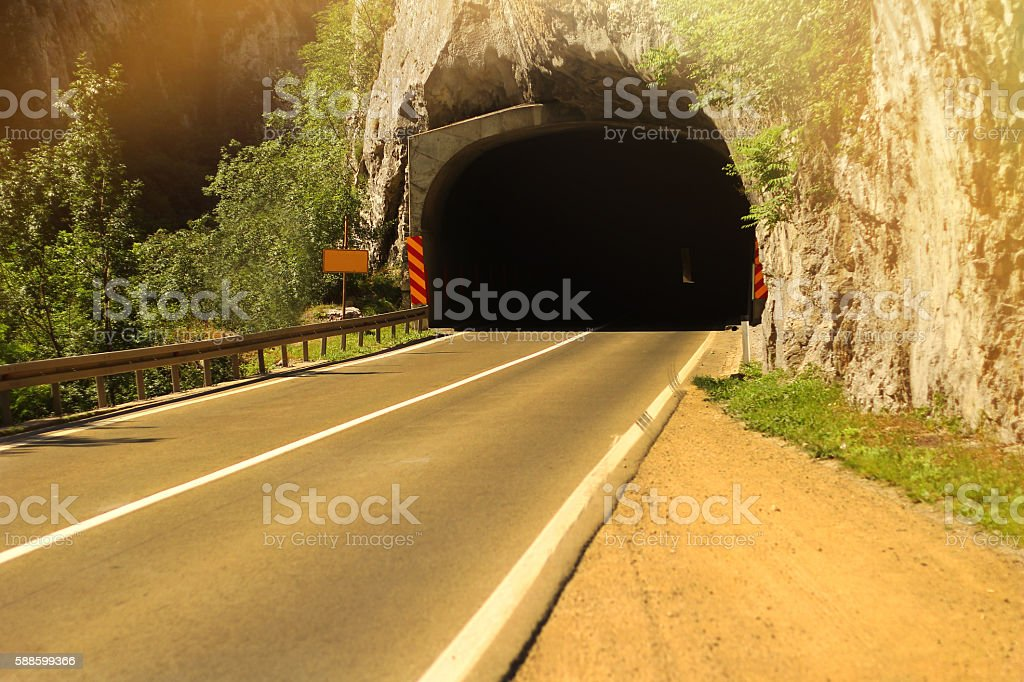 Road with tunnel and sunlight stock photo
