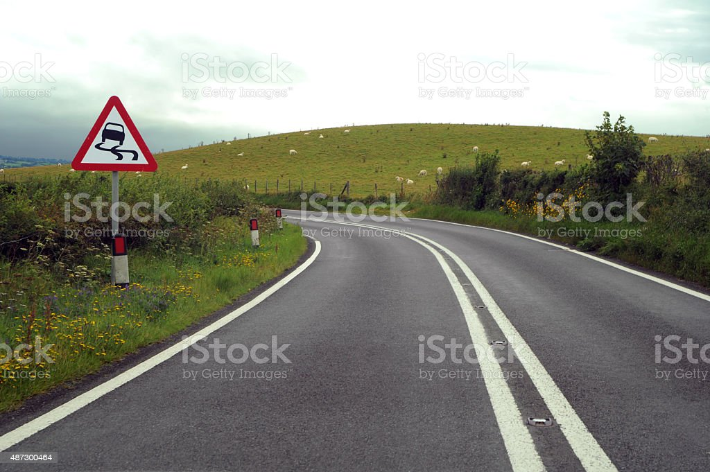 Road with Warning Sign stock photo