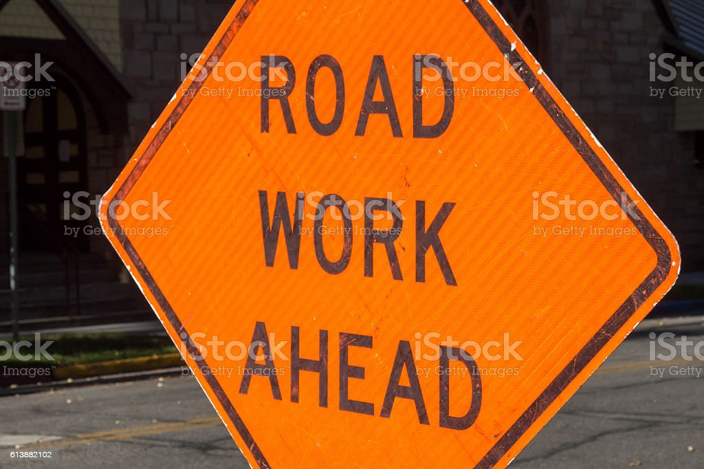 Road work ahead sign with dark background stock photo