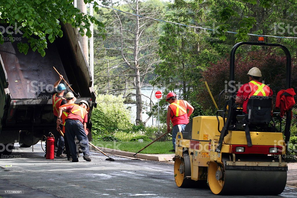 Road workers repairing a pothole stock photo