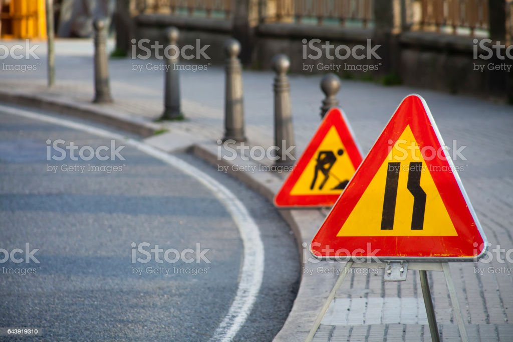 Road works, road narrowing ahead signs. stock photo