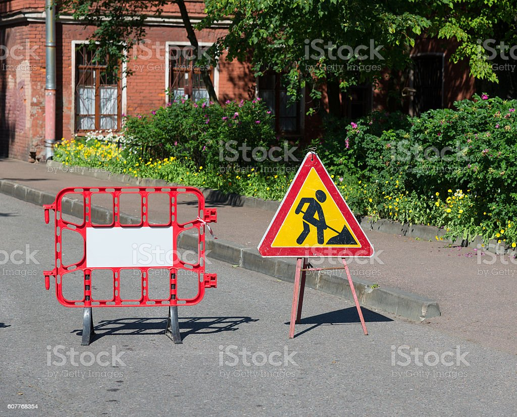 Road works sign for repairs in  courtyard stock photo