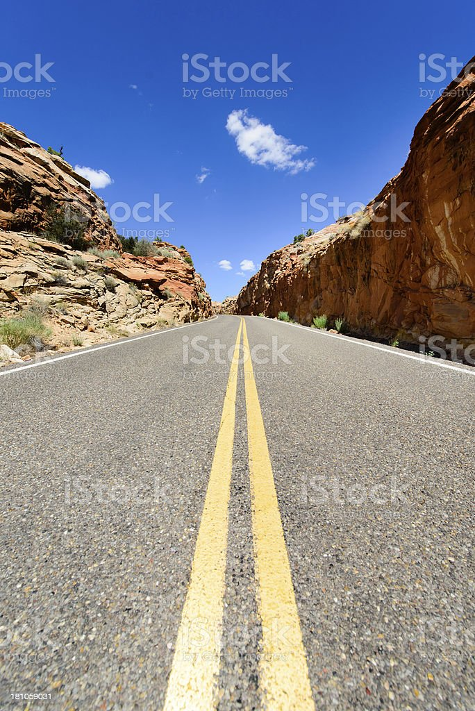 Road - Yellow Lines Between Red Rocks, Verticle royalty-free stock photo