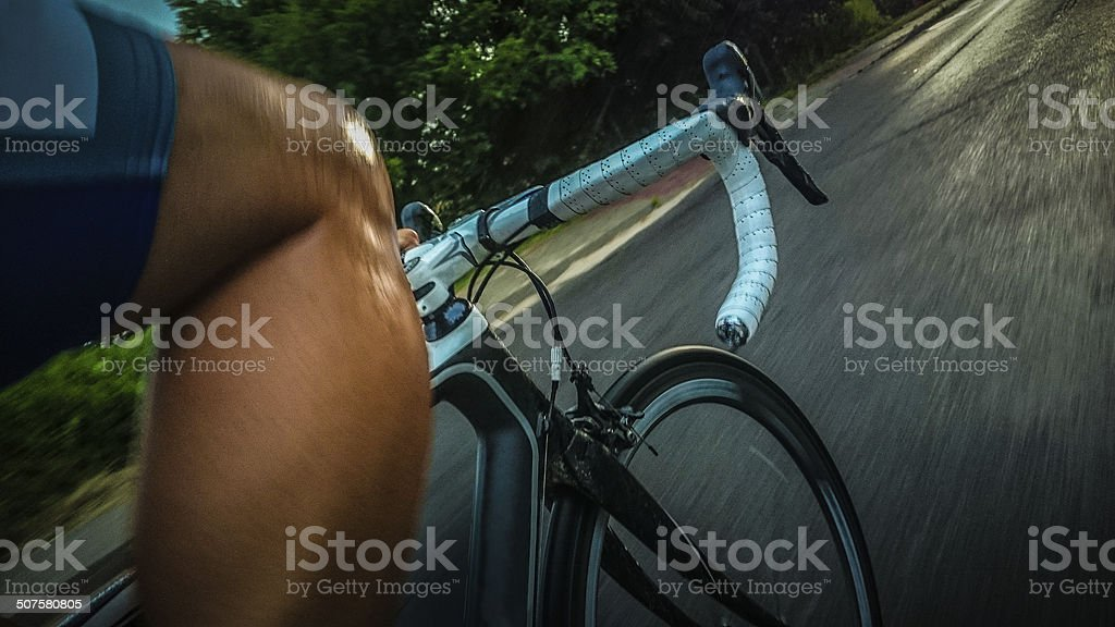 Roadcycling training during storm stock photo