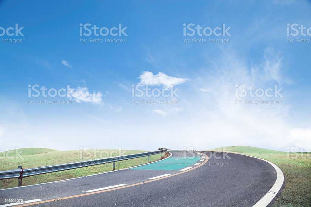 Roads and green grass Sky background. stock photo