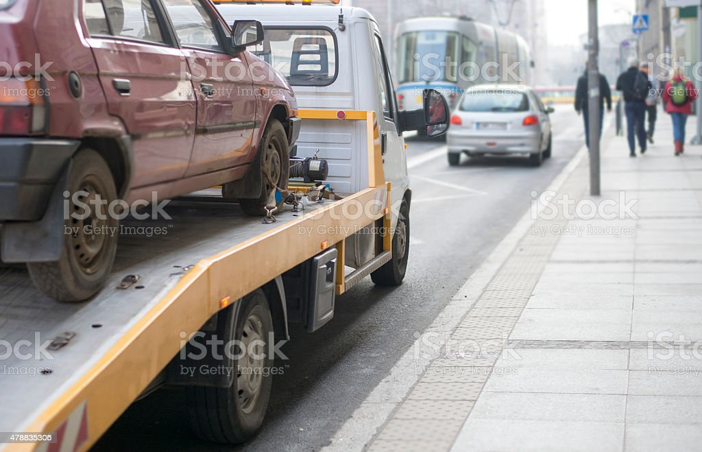 Roadside assistance car towing truck in the city stock photo