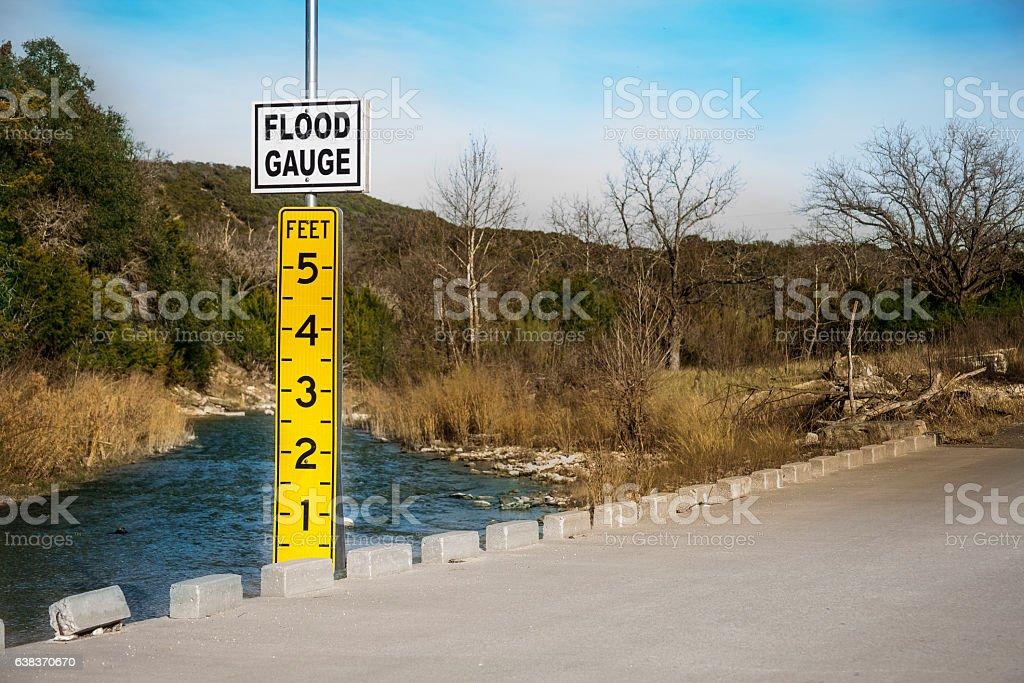 Roadside flood gauge beside river in Texas, USA stock photo