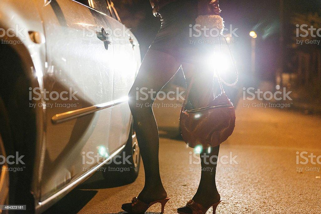 Roadside prostitute at night stock photo